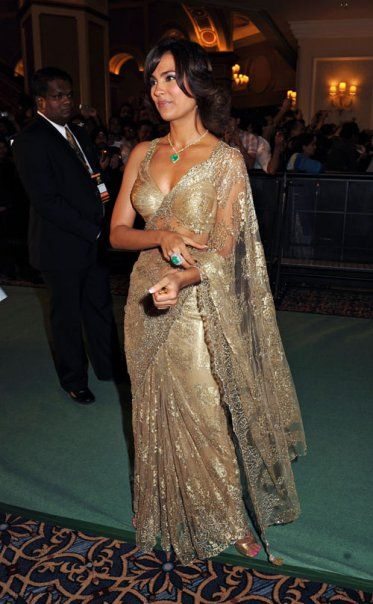 Lara Dutta in a gold lace sari or saree. #IndianFashion #CocktailSaree