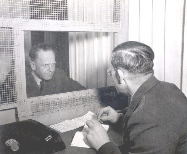 German Field Marshal Erhard Milch meeting with his brother and defense counsel Dr. Werner Milch during his war crimes trial, Nuremberg, Germany, early 1947