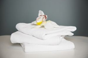 BedandBreakfast.com shares a two stage process for keeping your linens bright.