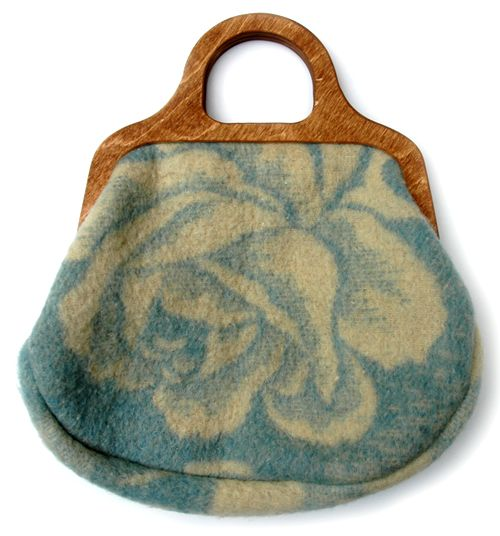 Tineke Beunders makes the Something Old, Something New bags from recycled woolen blankets. The only new addition is the wooden handle. Each bag is has a colorful cotton lining. Possible inspiration...