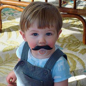 Kids wearing fake mustaches. That's All.