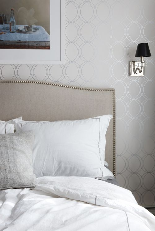 This silver patterned wallpaper lends a serene, calming feeling to Joshua and Jodie Steen's bedroom in their Brooklyn home.