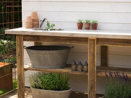 While this potting sink is located outside, its large, open shelves and long countertop make it the perfect workbench for gardeners. Bonus: The cabinet and countertop are made from recycled lumber.