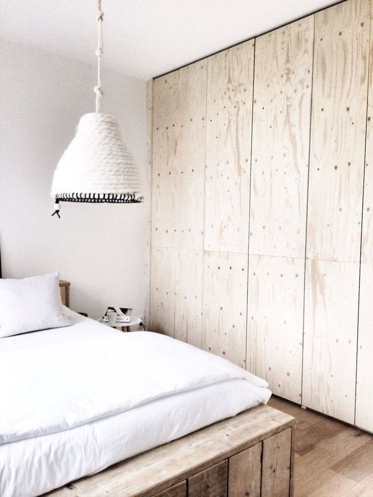 There isn't anything I DON'T love about this room. The use of floor to ceiling simple plywood cabinets is spot on the wood and white make this a cozy retreat