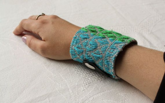 Woven green and blue linen cuff by NoctuaryArt on Etsy, 10e