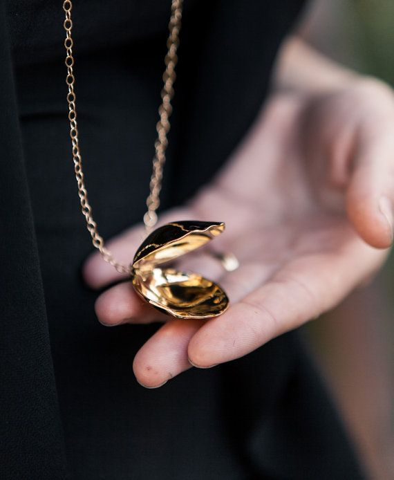 This gold plated mermaid shell locket can be opened and closed so you can keep in it things you want to hold close to your heart.  This piece is