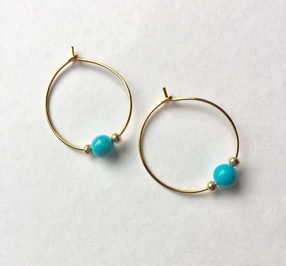 Hoop earrings with onyx and shell beads