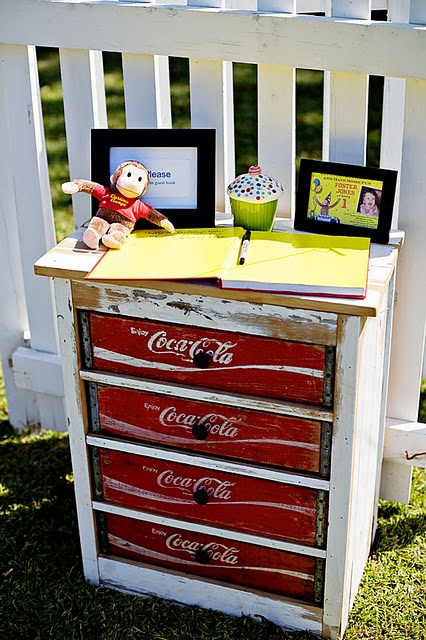 Curious George monkey 1st birthday party idea via Kara's Party Ideas - www.karaspartyideas.com. LOVE the Coca-Cola crate dresser / drawers!