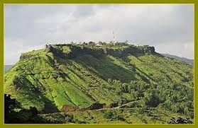 """Ajinkyatara fort (मराठी:अजिंक्यतारा) ( meaning """"The Impregnable Star"""") is a fort on one of the seven mountains surrounding the city of Satara in the Sahayadri Mountains of Maharashtra, India. It is a 16th-century fort that was called """"Ajimtara"""" during Aurangzeb regime and was based on Aurangzeb son's name, Ajim. Marathi novelist Narayan Hari Apte named the fort """"Ajinkyatara"""", when he wrote his very first novel on the same name (first published in 1909- Ref: His interview published in"""