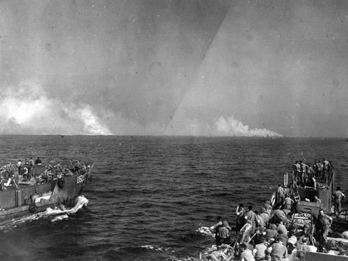LCTs on the way to Red Beach in the Bay of Cavalaire look through a naval bombardment of the beachhead.Operation Dragoon.
