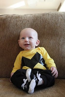Easy Infant Halloween Costume: Charlie Brown! All you need is a white onesie, some yellow clothing dye and black duct tape! Pair with black sweatpants and you have an easy DIY costume! A bald little baby also helps ;)