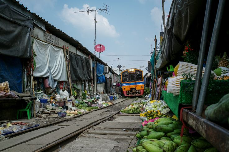 The exciting moment when a train passes the wet market which sits on a train track, the only one of its kind in Thailand!