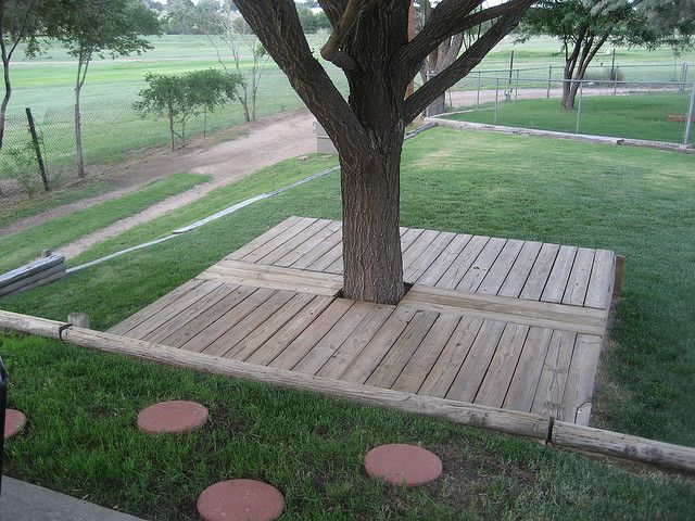 hidden sandpit - use as a deck/play area under the shade of the tree
