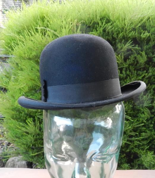 This vintage felt and leather Bowler/Derby hat will make any gentleman or master dapper. In good pre-loved condition, the ribbon on the brim is coming up in pla