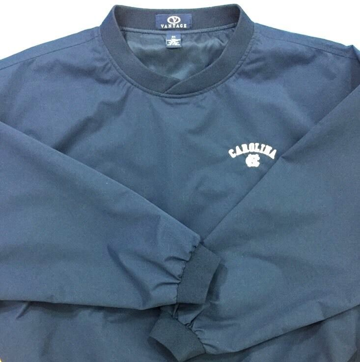 """Go Tar Heels! Calling all UNC fans. peached microfiber v-neck pullover with """"Carolina"""" and the NC logo embroidered on the left chest area. (University of North Carolina). V-neck pullover windbreaker or wind shirt with a soft, peached microfiber outer layer, and a smooth nylon lining.   eBay!"""