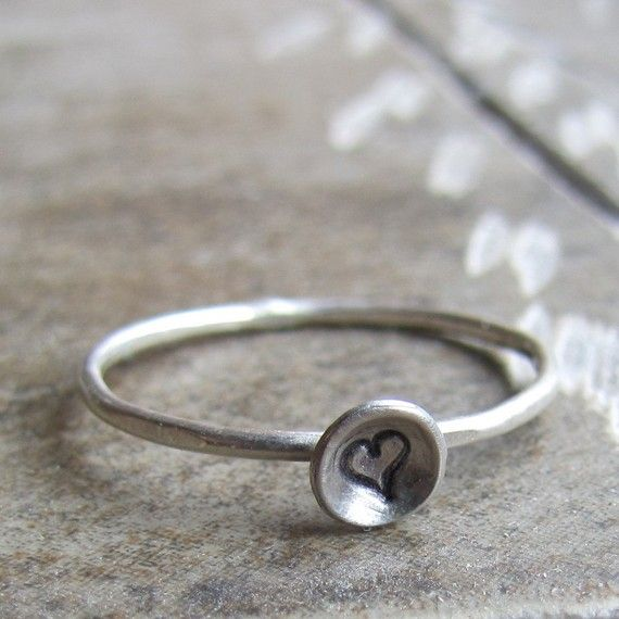 This listing is for one ring.  Unique sterling silver monogram ring with a heartthat I made from a skinny band with a tiny 3/16 disc Make a monogram set with your initials and a heart. This would make a great graduation gift for that special young woman, or a wedding gift for your bride.   I can make this ring in any size. For your own benefit, please be sure of your ring size as there is a fee to resize your made to order ring.  I can also make this design in 14k white gold, or 14k yellow…