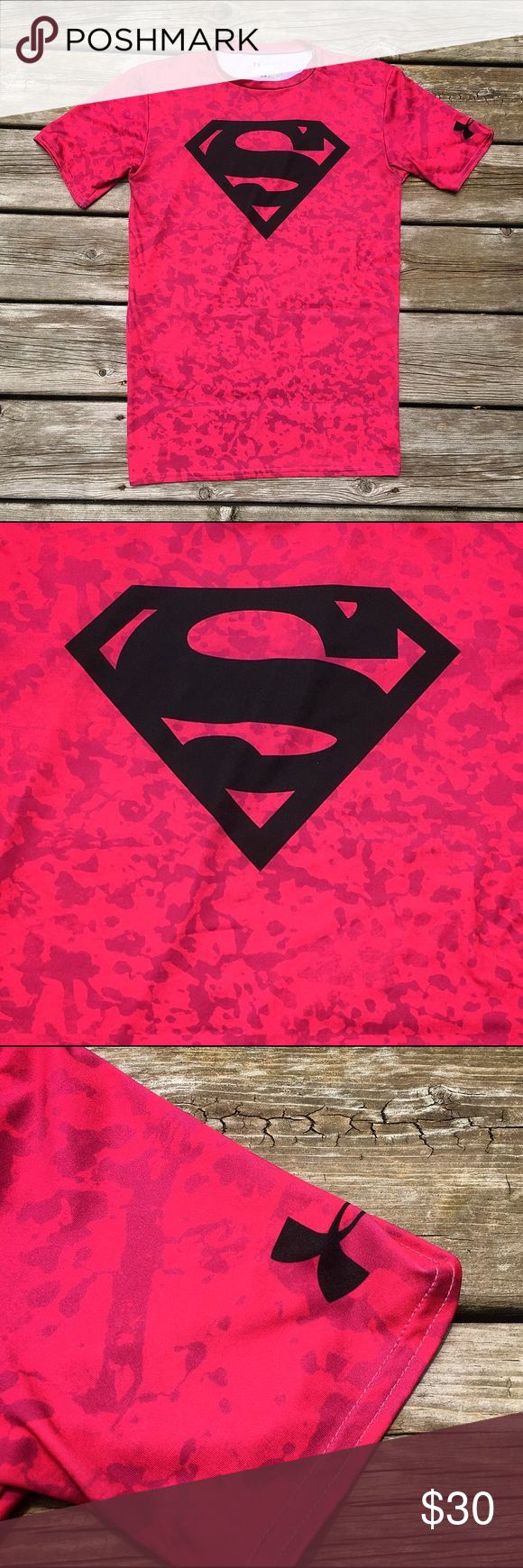Under Armour Alter Ego Superman Compression Shirt This is a men's short sleeve Under Armour compression shirt. This shirt is a dark pink w/ splotches & is part of their Power in Pink collection. As a part of their Alter Ego collection, this shirt also contains a black Superman logo.   It is composed of HeatGear fabric which allows for increased mobility. This shirt has a moisture transport system, anti-odor technology, and UPF 30+. Wonderful workout shirt to add some color to your wardrobe…