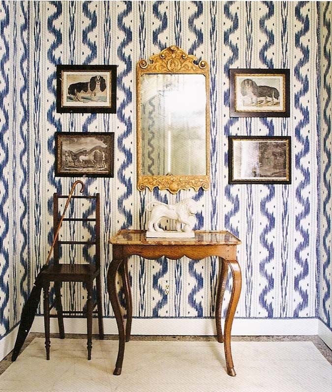 "The scale of the dog prints works wonderfully on this dynamic wallpaper by Pierre Frey, ""Toile de Nantes""; Interior Design/Photo by Celerie Kemble"