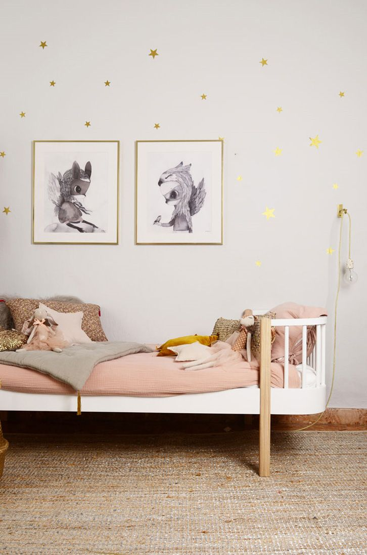 blush pink, white and metallic gold star decals on the wall
