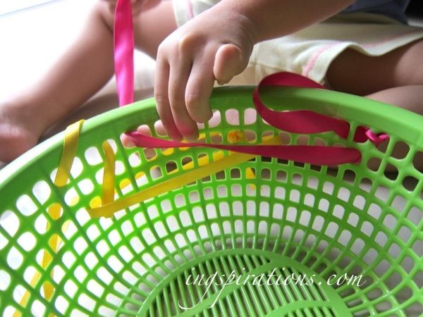 Threading activity for toddlers. Using ribbons and baskets, which are easily found around the house. Great for fine motor skills and hand eye coordination! Good sensory play too!