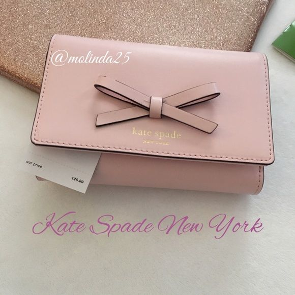 Kate Spade NY Sawyer Street Callie Clutch Wallet  100% Authentic Kate Spade Clutch Wallet. Beautiful smooth ultra soft leather with a bow on front, snap close with Long Bill slot, 6 credit card slots, ID window, and zipped coin compartment. Kate Spade gold engraving on front. Color: Posy Pink  No trades or PP. NOTE: Over looked manufacture imperfection (top left of bow). REASONABLE OFFERS ARE WELCOME  kate spade Bags Wallets