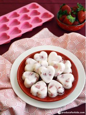 These bite-sized strawberry & yogurt bites are a sweet and delicious treat for Valentine's Day (or any day!). Let kids help mix the ingredients and fill molds for a fun activity. This recipe call for plain Greek yogurt sweetened with a little honey, but any flavor or type of yogurt can be substituted.