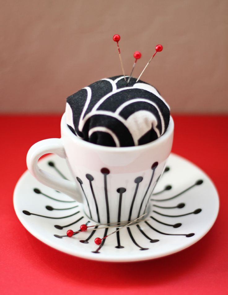 Diy pin cushion. Great gift for the sewers in my life!  Thrift stores have tons of these cappaccino cups.
