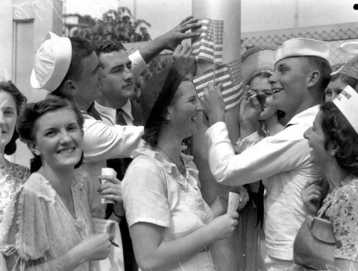 "Women with visiting American sailors, Brisbane, Queensland, 1941 ""The Americans gave presents to the girls and won them over, which was extraordinarily annoying for the Australians. But my mother encouraged me to invite Americans home and we always had oodles of people for dinner... I went out with several Americans; I was very innocent and very good, and I had a wonderful time with them. "" [Marjorie Robertson, who lived in East Brisbane] Neg: 104176 John Oxley Library, State library of QLD"