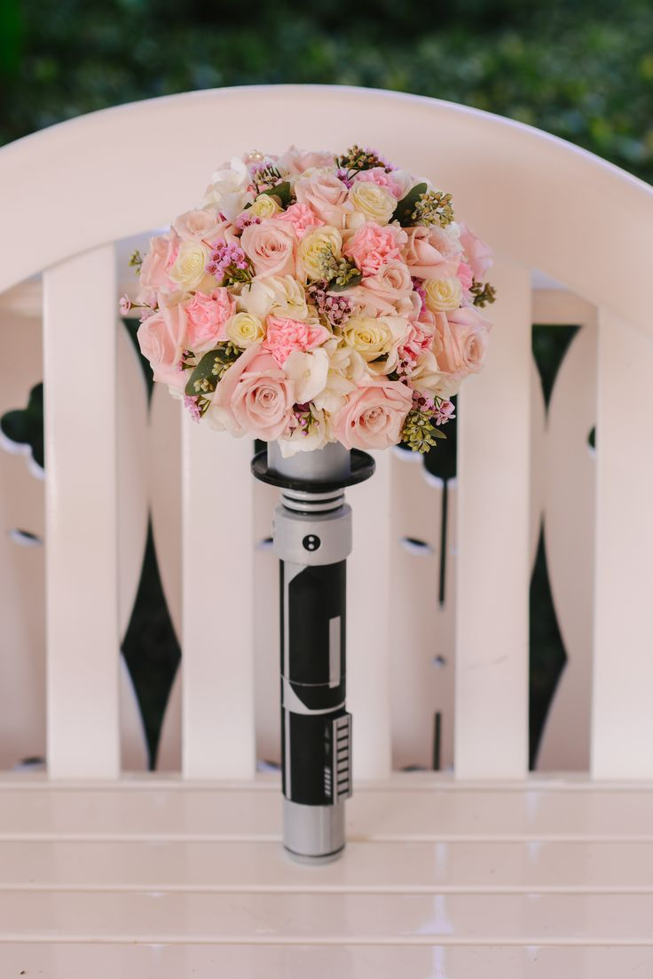 Lightsaber bouquet for a Walt Disney World, Star Wars loving bride. Photo: Brittany, Disney Fine Art Photography