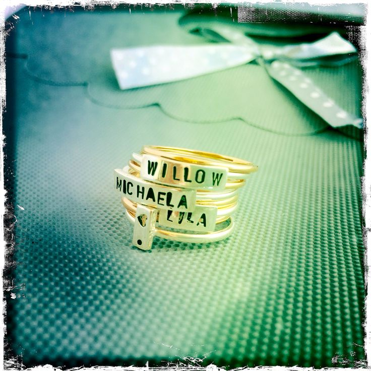 Silver Name rings with Rose gold stacking rings.