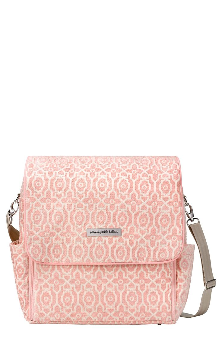 This adorable pink diaper bag makes it easy to carry the essentials while on the go.