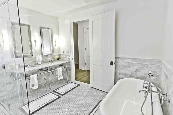 bathrooms - Benjamin Moore - Decorators white - tub carrera marble double sinks hexagonal tiles  The master bathroom was designed with tradition