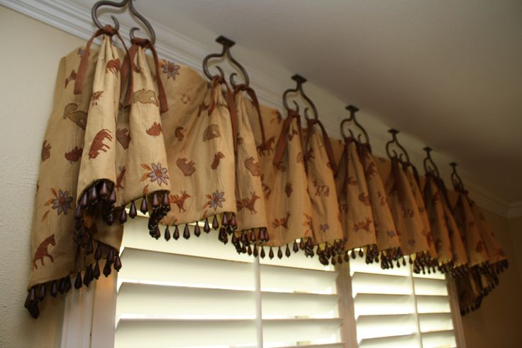 Creative window brackets!  We can make these or any other design you can think of.  www.metroiron.net