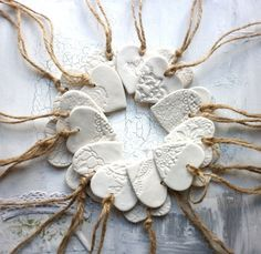 A Set Of 4 Handmade Porcelain Heart Decorations
