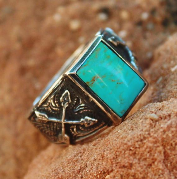 Crossed Arrow Turquoise Ring is sterling silver with a 10mm X 14mm bezel set Kingman Turquoise. This ring is awesome for men or women, available in sizes 5 through 13. Due to the uniqueness of turquoise, stone color will vary. This ring can be ordered on our site for $119.