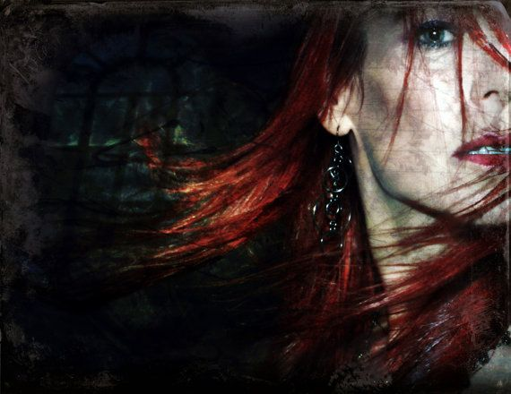 """Title: """"ill wind, blow away...""""  Portrait of a red haired woman, hair whipping in the wind."""
