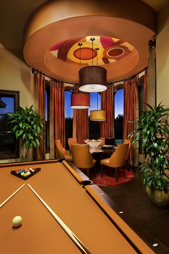 Love the art on the ceiling. I know from a previous picture this is a dining room table but I would make it a game table - poker anyone?