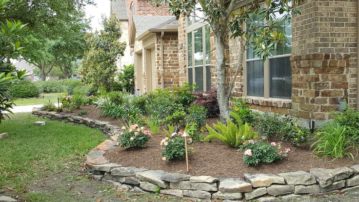 Classic Houston area raised flowerbed edged with stacked