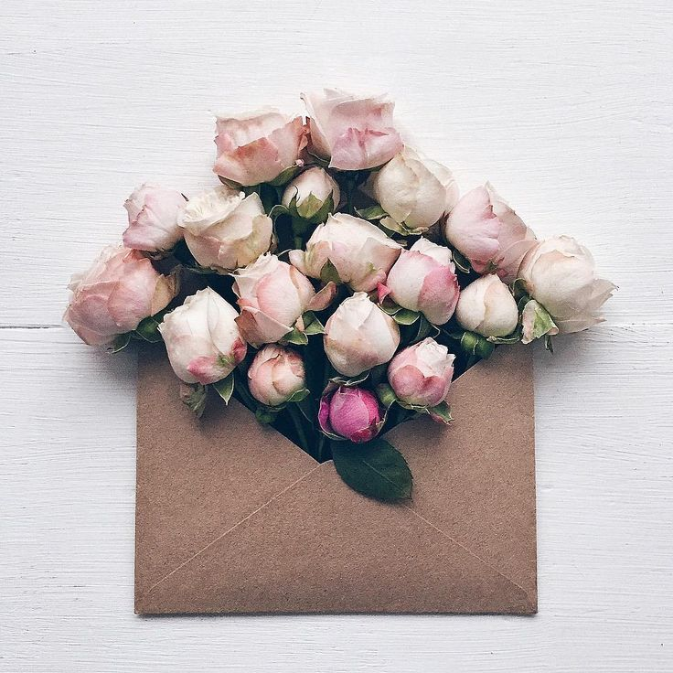 An envelope filled with roses.