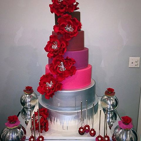 """Loving the colors of this awesome wedding cake covered in our 6"""" Large Red Peonies. Cake artfully designed by @etcakes"""