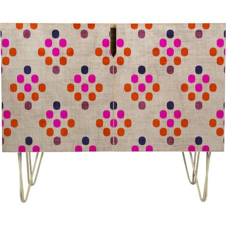 Stylist's Tip: Experiment with eye-catching furniture to make small spaces feel large and infuse your home with your personal style. This bold sideboard pops...