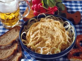 If we're going to a beer garden, I think I may need to try this: Obazda. Mmmm Camembert and onions and pretzels oh my!