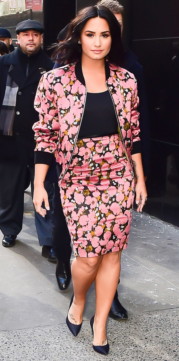 Demi Lovato showed us how to pair a bomber jacket with a pencil skirt. Outside of Good Morning America, the musician wore a pink satin matching set with a black top and contrast trim. Lovato scaled back on the accessories, opting for just a pair of blue suede pumps by Nicholas Kirkwood. Look of the Day - Demi Lovato from InStyle.com