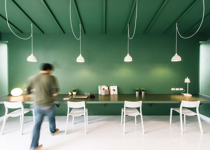 Contrasting green and white ceilings and walls feature throughout this office and lobby for a TV production company