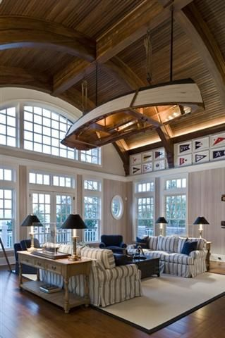Beach House Decor with canoe lighting. Beautiful room.