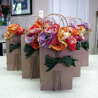 What pretty posie packages! Tutorial for eco-friendly paper blossoms is included.