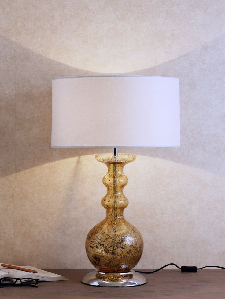 Antero a mercury glass table lamp makes a wonderful accent for a transitional bedroom or