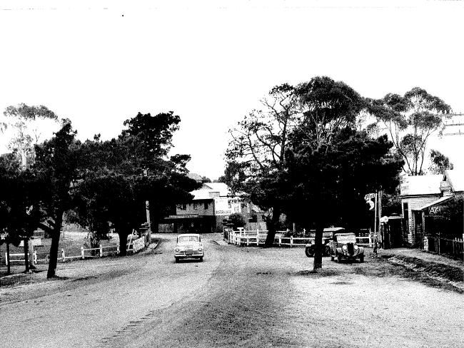 """April 1950: The handwritten caption on the back of this image describes it as the """"township of Broadmeadows"""". It is actually a street in Westmeadows that was the site of the original Broadmeadows village. You will notice some older-model cars to the right while a more modern vehicle is pictured in the centre of the road. Picture: Herald Sun Image Library/ARGUS"""