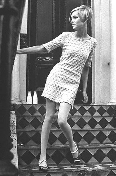 Twiggy wearing Mary Quant.  Every girl wished she was that thin...but since that wasn't going to happen...they'd settle for wearing their eye make-up the way she did....with the huge painted on lashes!