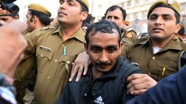 A court in India sentences an Uber taxi driver to life in prison for raping a female passenger last year in Delhi.